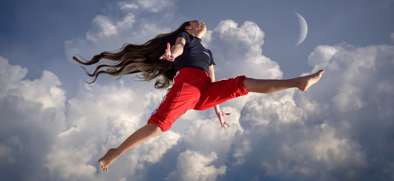 woman jumping with cloudy background