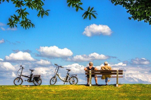 two elderly cyclists taking a break
