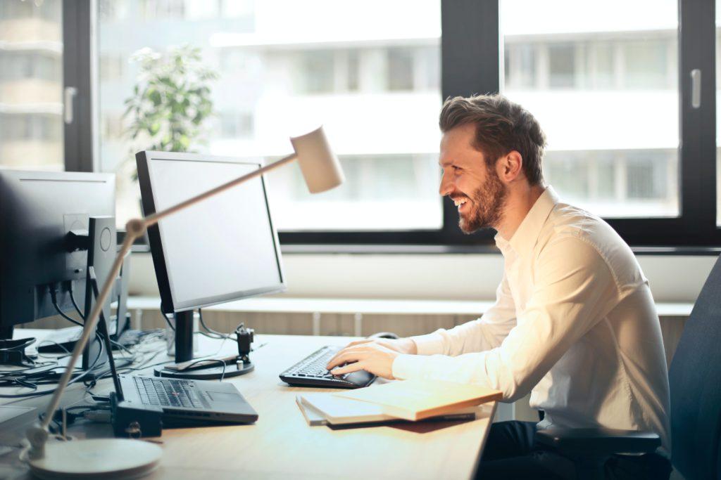 man sitting working on computer
